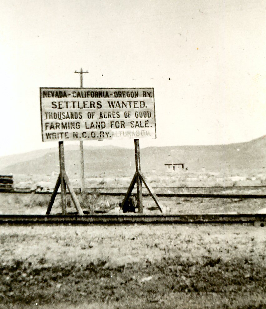 This weathered sign of the NCO was updated to show that its headquarters had moved from Reno to Alturas. Photograph taken by Lassen County Librarian Lenala Martin at Wendel, 1920.